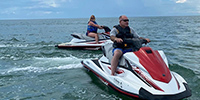 two people on jet skis