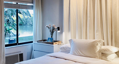 queen bed by a window with water views